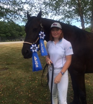 Linda and Will with blue ribbon